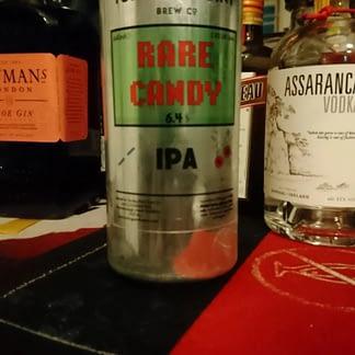 Silver can amongst spirit bottles